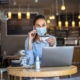 woman-in-mask-in-cafe-using-gift-card