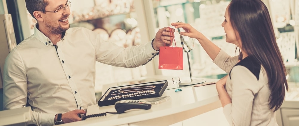 woman-buying-gift-at-retail-checkout